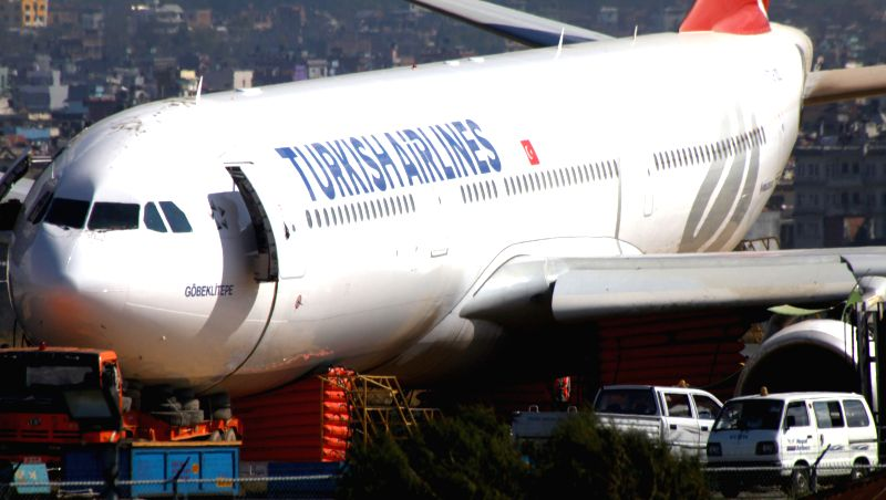 Photo taken on March 6, 2015 shows the crash-landed Turkish Airlines Flight TK726 on the grassland during the process of pushing it back to the runway at ...