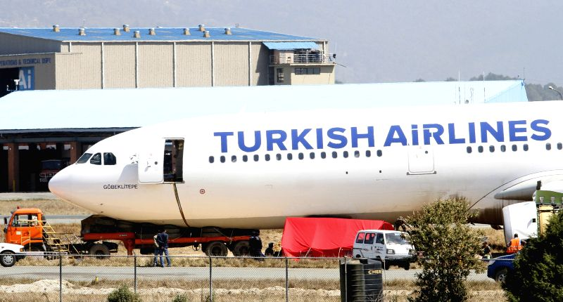 Photo taken on March 6, 2015 shows the crash-landed Turkish Airlines Flight TK726 during the process of pushing it back to the runway at Tribhuwan International ...