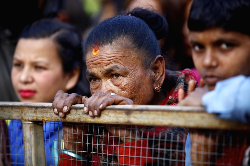Nepalese women watch a concert marking the International Women's Day in Kathmandu, Nepal, March 8, 2015.