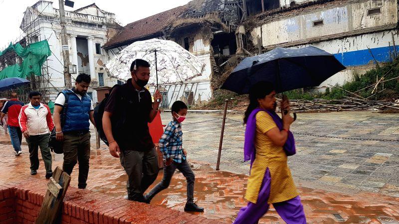KATHMANDU, May 1, 2017 - Nepalese people walk under umbrellas after rainfall at Hanumandhoka in Kathmandu, Nepal on May 1, 2017.
