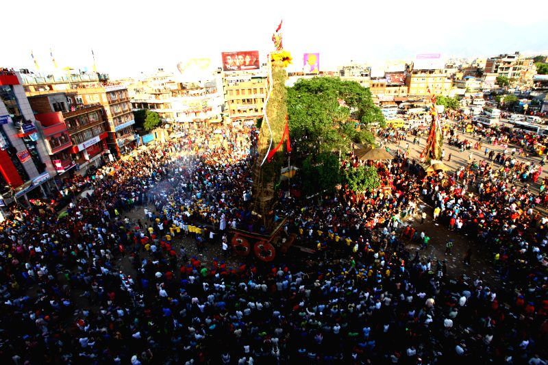 Devotees pull the chariots of Rato (Red) Machhendranath and Minnath during the Rato Machhendranath festival at Lagankhel, Lalitpur, Nepal, May 10, 2014. Rato ...