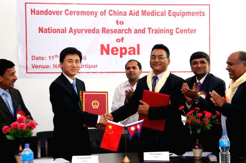 KATHMANDU, May 11, 2016 - Peng Wei (2nd L), economic counselor of the Chinese Embassy to Nepal, and Shanta Bahadur Shrestha (3rd R), secretary at the Nepalese Ministry of Health and Population, shake ...