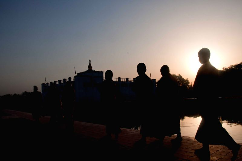 Buddhist monks walk at Mayadevi temple on the occasion of Lord Buddha's birthday in Lumbini, Nepal, May 14, 2014. Buddha Jayanti, sometimes informally called ...