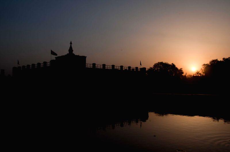 "Photo taken on May 14, 2014 shows sun rising at Mayadevi Temple in Lumbini, Nepal. Buddha Jayanti, sometimes informally called ""Buddha's Birthday"", is a ."