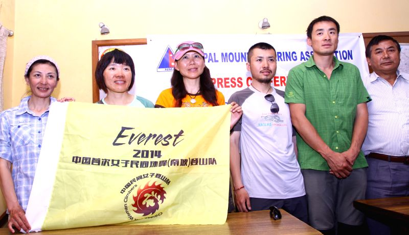 Members of private Chinese women expedition and Nepal Mountaineering Association pose for a group photo after a press conference held in Kathmandu, Nepal, May 16, .