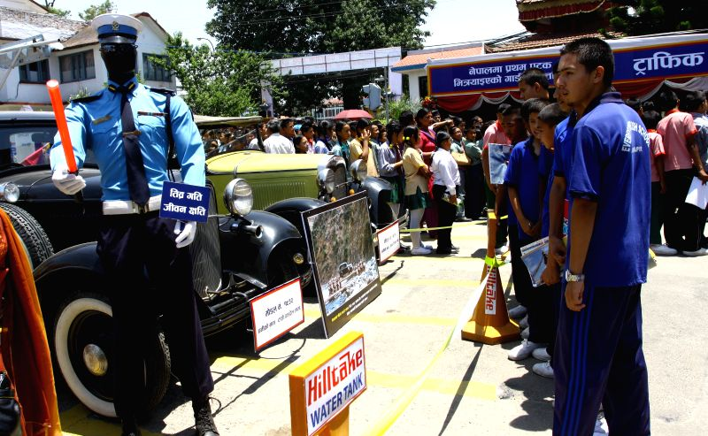 Students visit the Road Safety exhibition organized by Metropolitan traffic police in Kathmandu, Nepal, May 16, 2014. The exhibition aims to arouse awareness of ...
