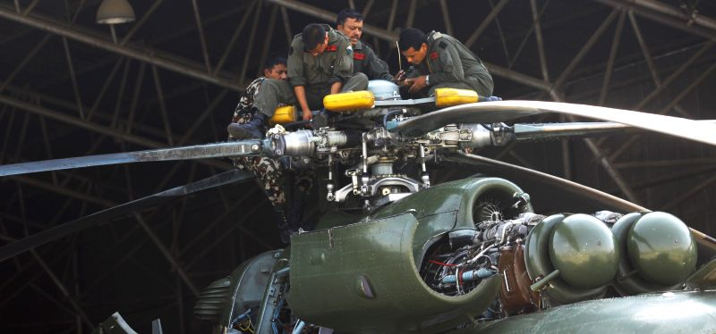 Nepalese Army personnel make a regular maintenance for an army chopper in Kathmandu, Nepal, May 17, 2015. Three bodies had been recovered near the wreckage of a ...