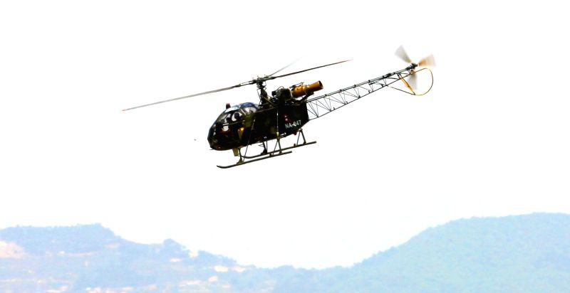 Photo taken on May 17, 2015 shows a Nepalese army chopper, which spotted the suspected wreckage of a U.S Marine helicopter, landing at the airport in Kathmandu, ...