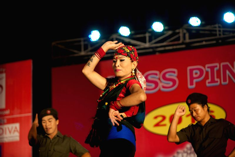 KATHMANDU, May 18, 2016 - A Nepalese transgender (C) performs dance during the Miss Pink Beauty Pageant in Kathmandu, Nepal, May 17, 2016. A total of 18 transgender models from across the country ...
