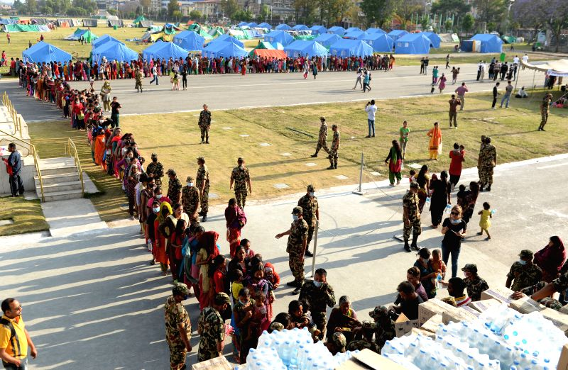 People line up for supplies in Kathmandu, Nepal, on May 2, 2015. The death toll from last Saturday's powerful earthquake in Nepal reached 6,659 and a total of ...