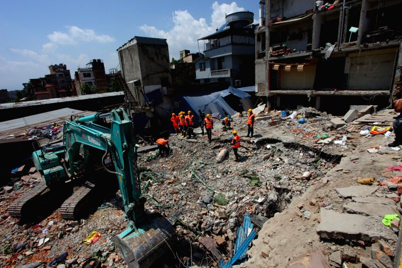 Rescuers work on debris after the massive earthquake on April 25 in Kathmandu, Nepal, May 2, 2015. The death toll of the earthquake climbed to 6,659 and 14,062 ...