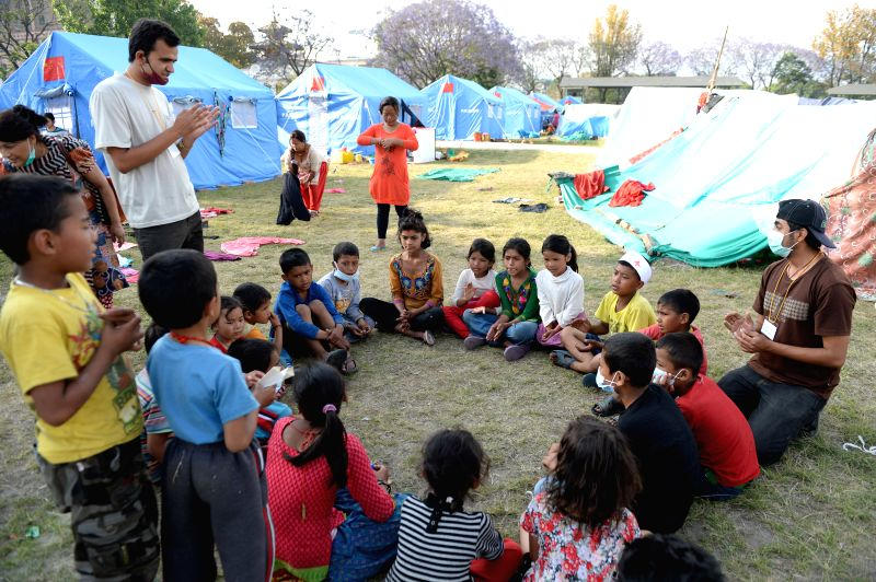 Volenteers play games with children in Kathmandu, Nepal, on May 2, 2015. The death toll from last Saturday's powerful earthquake in Nepal reached 6,659 and a total ...