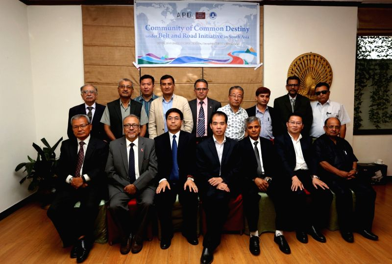 "KATHMANDU, May 23, 2016 - Experts pose for a group photo as they participate in a seminar entitled ""Community of Common Destiny under Belt and Road Initiative in South Asia"" organized by ..."