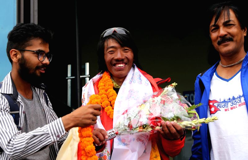KATHMANDU, May 24, 2016 - Phurba Tenjing Sherpa (C), who successfully climbed Mount Qomolangma for 10 times, is welcomed after returning from Mount Qomolangma at the airport in Kathmandu, Nepal, May ...