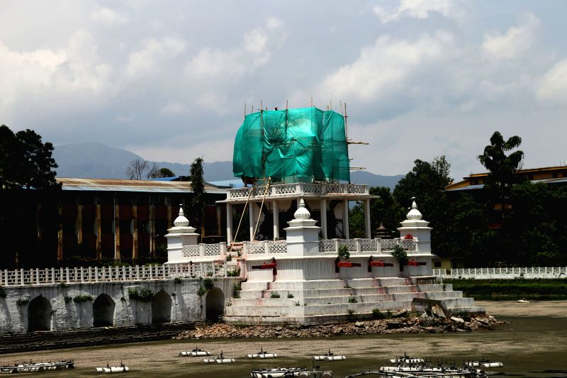 KATHMANDU, May 26, 2016 - Photo taken on May 25, 2016 shows a temple inside Ranipokhari, a historic artificial pond under reconstruction, in Kathmandu, Nepal. The pond was built in the 17th century ...