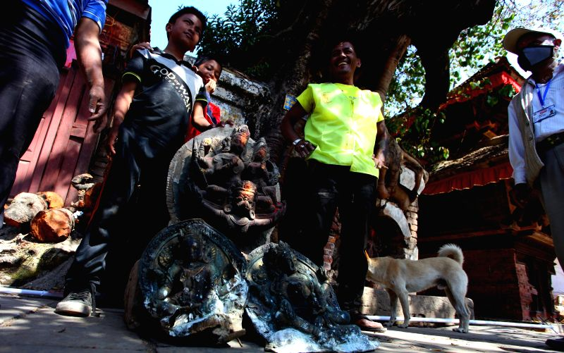 Rescuers stand with idols found from damaged temples in Kathmandu, Nepal, May 3, 2015. Death toll from the powerful earthquake in Nepal has climbed to 7,240 on ...