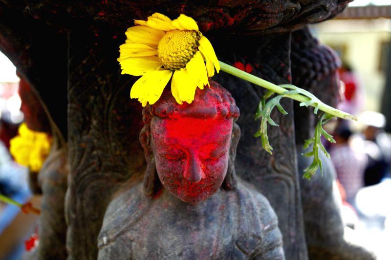 A flower is put on the idol of Lord Buddha to mark Buddha Jayanti festival in Kathmandu, Nepal, May 4, 2015. Buddha Jayanti, sometimes informally called ...