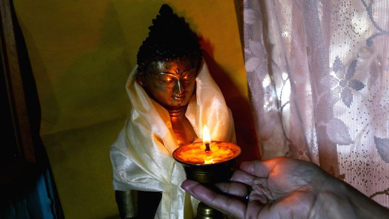 A Nepalese Buddhist woman offers prayers during Buddha Jayanti festival at a monastery in Kathmandu, Nepal, May 4, 2015. People visited Buddhist shrines and ...
