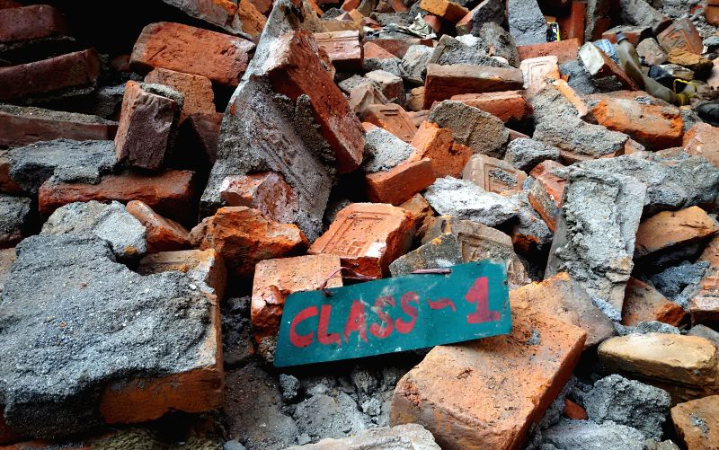 Photo taken on May 4, 2015 shows a class name plate on the rubbles of a damaged school in Kathmandu, Nepal. An estimated 5,000 schools were destroyed in the April ... - Sunil Sharma