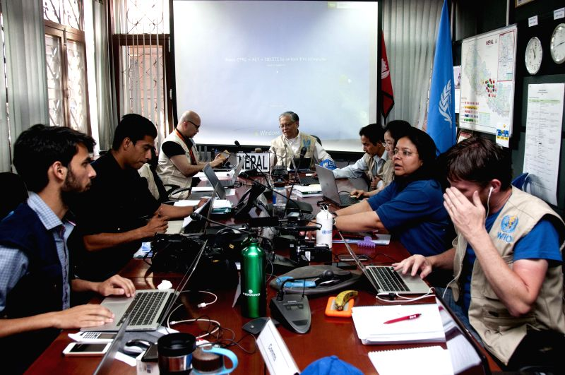 World Health Organization (WHO) team members discuss during a meeting in Kathmandu, Nepal, May 6, 2015. World Health Organization (WHO) played down the risks of an ...