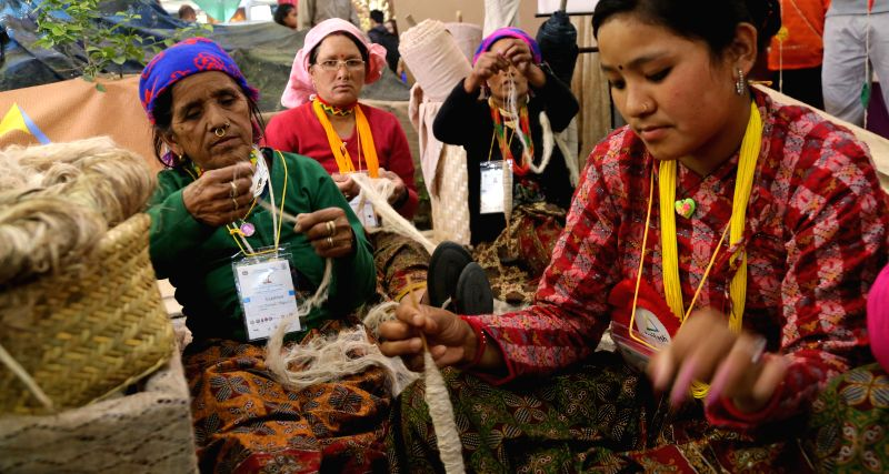 KATHMANDU, May 8, 2016 - Women display their traditional skills during the 13th Handicraft Trade Fair in Kathmandu, Nepal, May 8, 2016. The fair was organized by the Federation of Handicraft ...