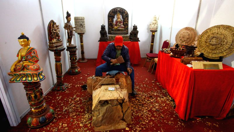 Kathmandu (Nepal): A craftsman works on woodcarving during the Handicraft Exhibition and 12th Handicraft Trade Fair for the South Asian Association of Regional Cooperation (SAARC) summit in ...