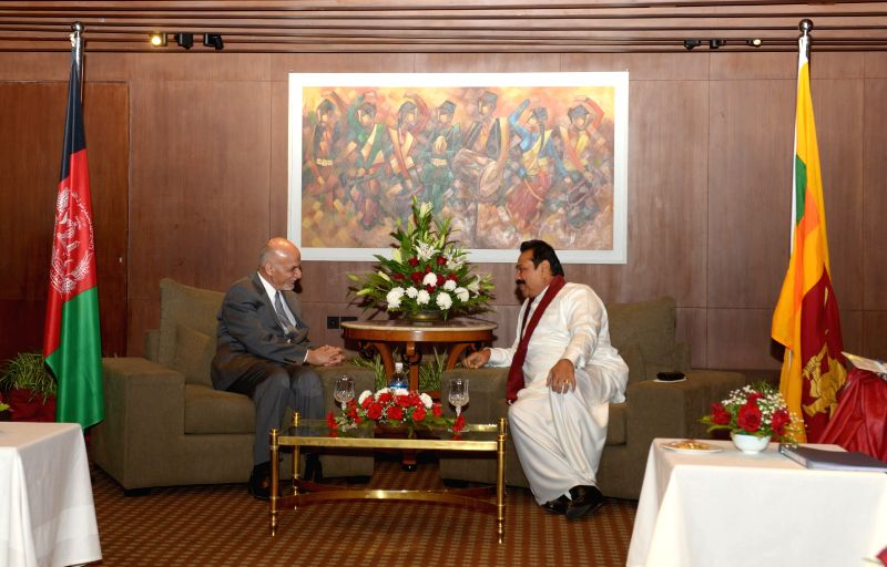 Kathmandu (Nepal): Afghan President Mohammad Ashraf Ghani (L) meets with Sri Lankan President Mahinda Rajapake ahead of the 18th South Asian Association for Regional Cooperation (SAARC) summit in ...