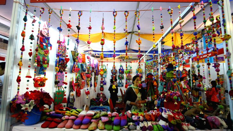 Kathmandu (Nepal): An exhibitor sells products during the Handicraft Exhibition and 12th Handicraft Trade Fair for the South Asian Association of Regional Cooperation (SAARC) summit in Kathmandu, ...