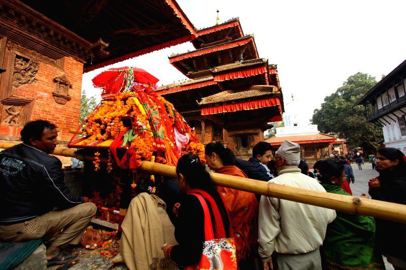 Kathmandu (Nepal): Devotees offer prayers during the celebration of Rath Yatra or the Chariot Festival at Hanumandhoka in Kathmandu, Nepal, Nov. 18, 2014.
