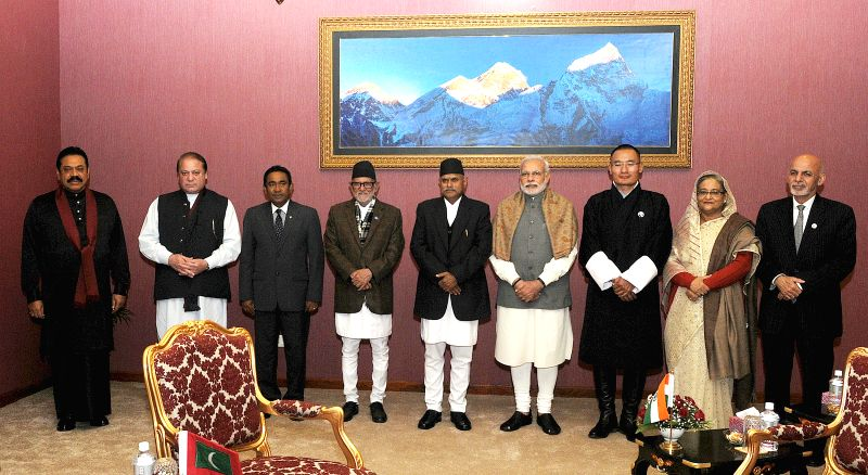 Kathmandu (Nepal): Leaders pose for a group photo after the closing session of the 18th South Asian Association for Regional Cooperation (SAARC) summit in Kathmandu, Nepal, Nov. 27, 2014. The 18th ...