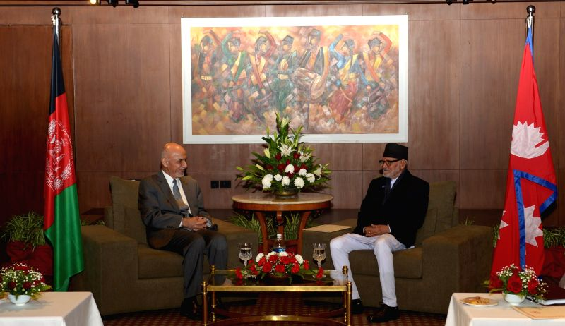 Kathmandu (Nepal): Nepalese Prime Minister Sushil Koirala (R) meets with Afghan President Mohammad Ashraf Ghani ahead of the 18th South Asian Association for Regional Cooperation (SAARC) summit in ... - Sushil Koirala