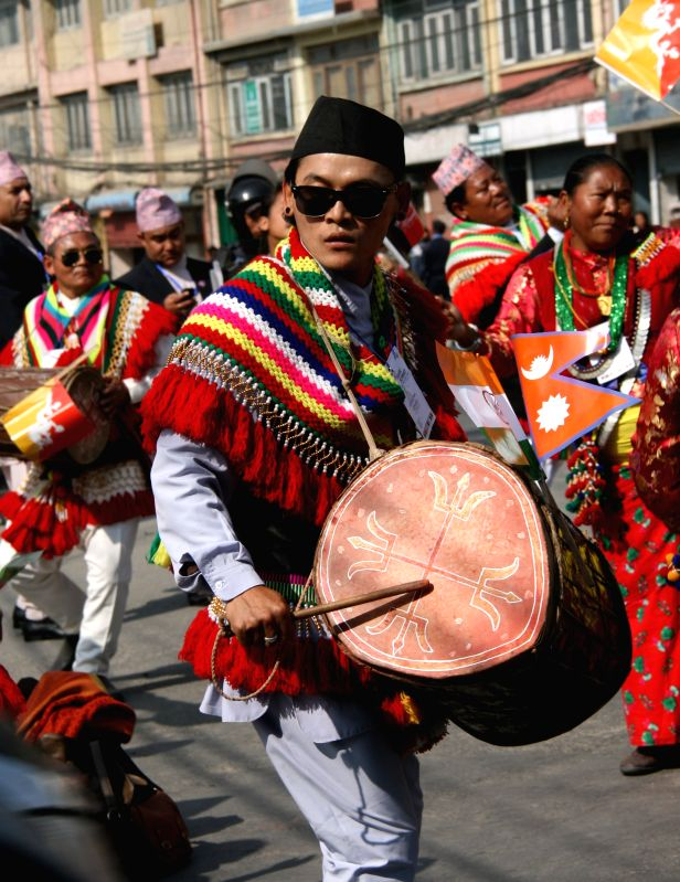 Kathmandu (Nepal): Nepalese youth in traditional attire perform to welcome the arrival of the head of states of host countries in Kathmandu, Nepal, Nov. 25, 2014. After two years' postponement, the ..