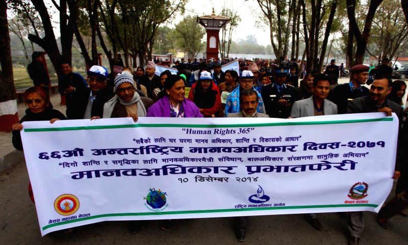 Kathmandu (Nepal): People take part in a rally marking the International Human Rights Day in Kathmandu, Nepal, Dec. 10, 2014. The International Human Rights Day is observed on Dec. 10 annually. ...
