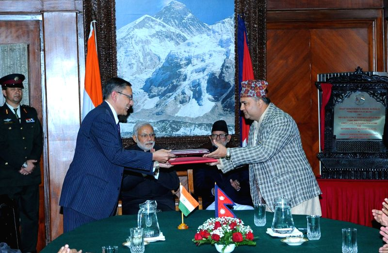 Kathmandu (Nepal): Representatives from Nepal and India exchange the documents of Arun III hydropower project on the sidelines of the 18th summit of the South Asian Association for Regional ...