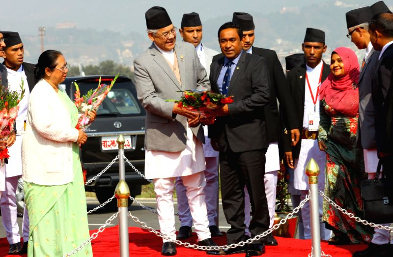 Nepal's Deputy Prime Minister and Home Minister Bam Dev Gautam (L, front) welcomes Maldivian President Abdulla Yameen Abdul Gayoom (R, front) for the 18th South Asian Association for ... - Bam Dev Gautam