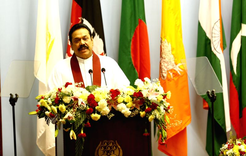 Kathmandu (Nepal): Sri Lankan President Mahinda Rajapaksa adresses his opening speech during the opening session of the 18th South Asian Association for Regional Cooperation (SAARC) Summit at City ...