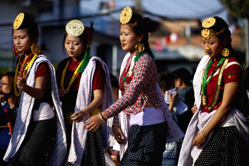 "Kathmandu (Nepal): Women from Kirat community dance ""Sakela"" to celebrate Udhauli Festival in Kathmandu, Nepal, Dec. 6, 2014. Udhauli is the annual festival celebrated by Kirat community of"