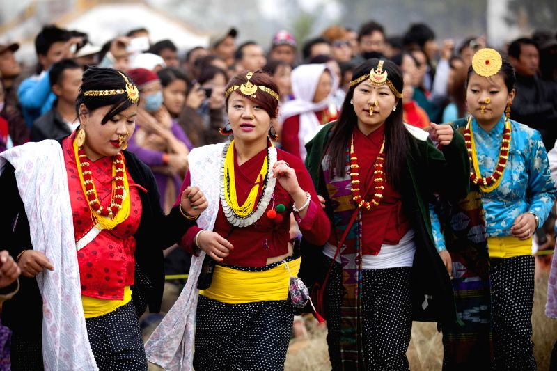 Nepalese girls from Kirat community in traditional costume and ornaments participate in Udhauli festival in Kathmandu, Nepal, Dec. 14, 2014. Udhauli is the annual festival celebrated by ...