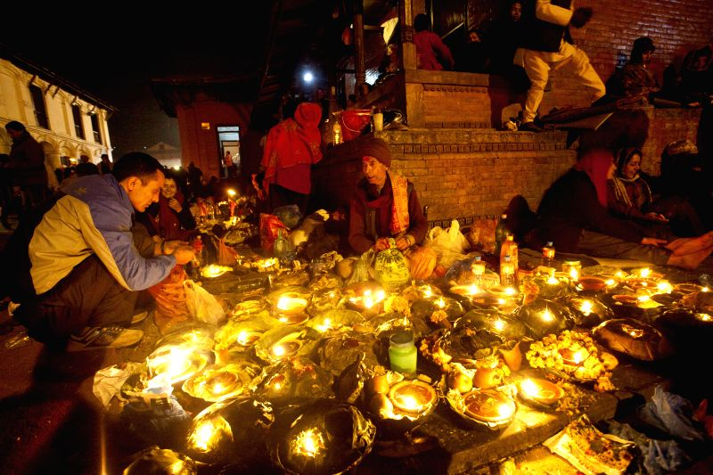 Nepalese Hindu devotees light oil lamps during Bala Chaturdashi festival at the Pashupatinath temple in Kathmandu, Nepal, Nov. 21, 2014. Bala Chaturdashi is celebrated in memory of ...