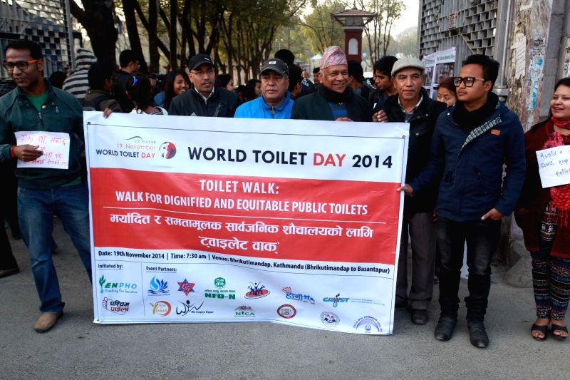 Nepalese people participate in the Toilet Walk: Walk for dignified and equitable public toilets on the occasion of World Toilet Day in Kathmandu, Nepal, Nov. 19, 2014. The 2014 World ...