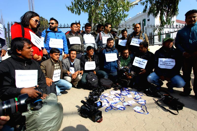 Nepalese photojournalists are seen in a symbolic protest with their issued accreditation cards for SAARC (South Asian Association for Regional Cooperation) summit on floor against the ...