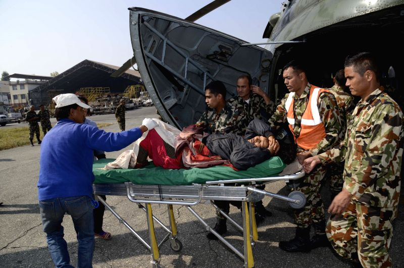 Photo released by the Nepal Army shows an injured victim of a road accident occurred in Durchhim being brought to a hospital in Kathmandu, Nepal, Nov. 21, 2014. At least six people was ...