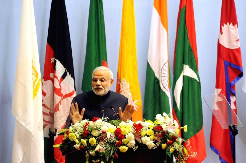 Prime Minister Narendra Modi addresses at the inaugural session of the 18th SAARC Summit, in Kathmandu, Nepal, on Nov 26, 2014. - Narendra Modi