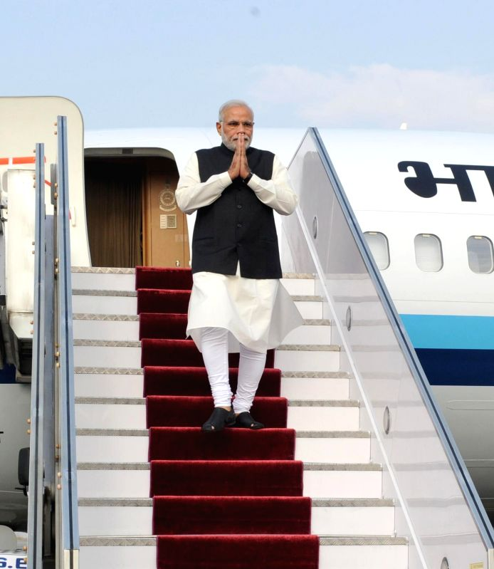 Prime Minister Narendra Modi arrives at Tribhuvan International Airport in  Kathmandu, to attend the 18th SAARC Summit, in Nepal on Nov 25, 2014. (Photo : IANS/PIB) - Narendra Modi