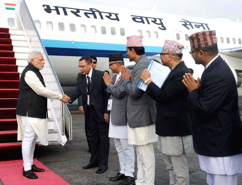 Prime Minister, Narendra Modi being received on his arrival at Tribhuvan International Airport, in Kathmandu, to attend the 18th SAARC Summit, in Nepal on Nov 25, 2014. - Narendra Modi
