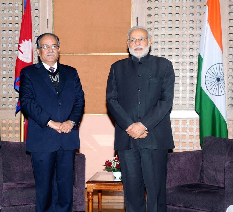 Prime Minister Narendra Modi during a meeting with the Chairman of UCPN (M), Pushpa Kamal Dahal Prachanda in Kathmandu, Nepal on Nov 25, 2014. - Narendra Modi