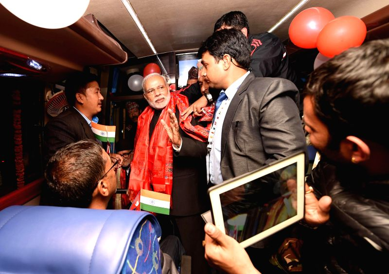 Prime Minister, Narendra Modi flags-off the Kathmandu-Delhi Direct Bus Service, in Kathmandu, Nepal, on Nov 25, 2014. - Narendra Modi