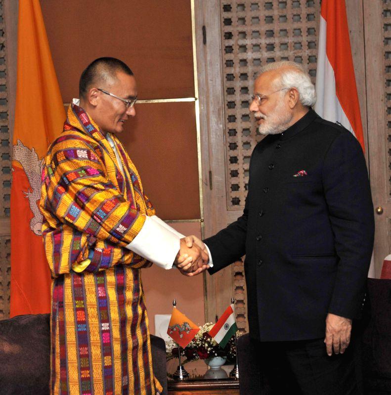 Prime Minister Narendra Modi meets Prime Minister of Bhutan Tshering Tobgay during the 18th SAARC Summit, in Kathmandu, Nepal, on Nov 26, 2014. - Narendra Modi