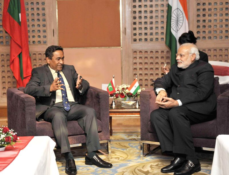 Prime Minister Narendra Modi meets President of Maldives Abdulla Yameen during the 18th SAARC Summit, in Kathmandu, Nepal, on Nov 26, 2014. - Narendra Modi
