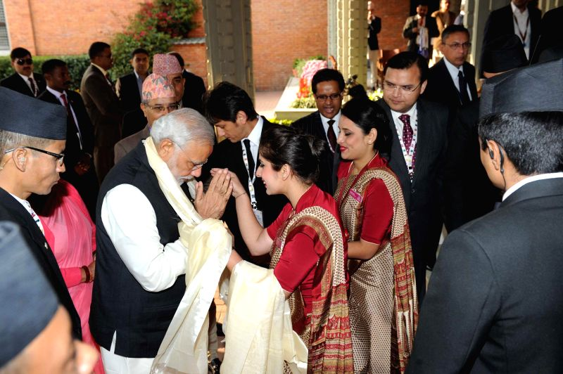 Prime Minister Narendra Modi receives a warm welcome on his arrival in Kathmandu, Nepal on Nov 25, 2014. Modi is visiting Nepal to participate in the 18th SAARC Summit - Narendra Modi